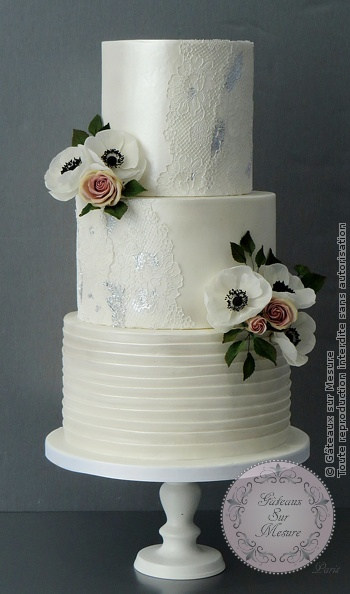 Lace and flower wedding cake